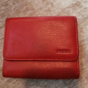 Fossil red trifold small wallet. Zipped back